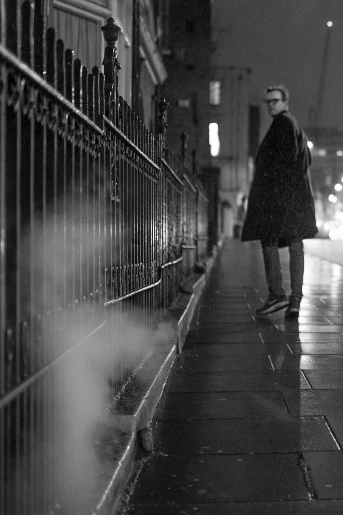 Pictures of man on the street in rain