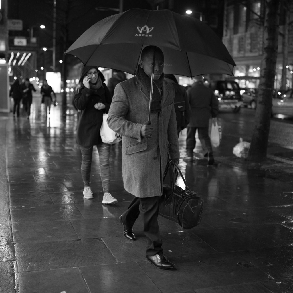 Blog - Man with umbrella in picture